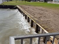 Vinyl Bulkhead with 2x6x16 piano key top cap. - Port Alto Texas - Replacement on old wooden Bulkhead. Used existing piling and new top whaler and tiebacks.