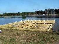 Pier built on private pond with 3 in. PVC pipe for post